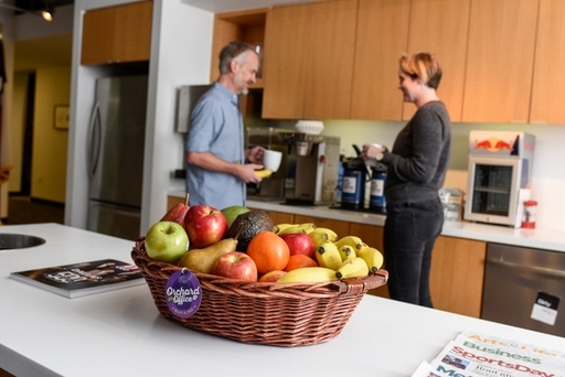employees_in_kitchen_behind_fruit_basket_small.jpg